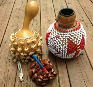 Various shekeres (aka shakers) Made with shell of various nuts, or beads. Pull or shake to play.